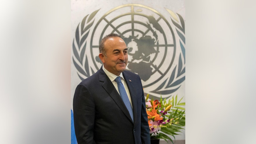 Turkey's Foreign Minister Mevlut Cavusoglu is photographed during a meeting with United Nations Secretary-General Antonio Guterres, Thursday, Jan. 5, 2017 at United Nations headquarters. (AP Photo/Mary Altaffer)