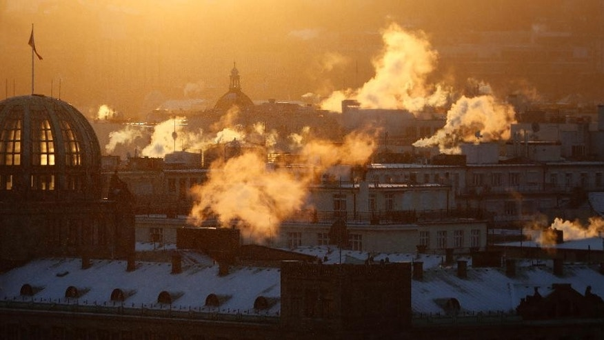 Smoke rises from chimneys during a freezing winter morning in Prague, Czech Republic, Friday, Jan. 6, 2017. (AP Photo/Petr David Josek)