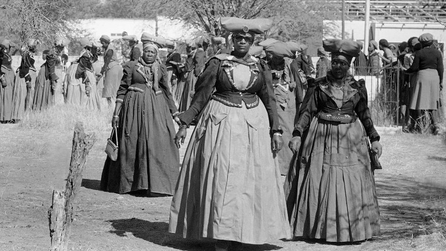"FILE - In this July 4, 1981 file picture women of the Herero tribe show their traditional dress in Windhoek. Germany says  Friday Jan. 6, 2017 it could make further payments to Namibia for the killing of 65,000 tribes people by German colonial troops during the early 20th century. Foreign Ministry spokesman Martin Schaefer says the two-year talks with Namibia's government ""aren't easy because it's a difficult topic.""  His comments come a day after representatives of the Herero and Nama tribes filed a class action complaint against the German government in the United States, seeking reparations and a place at the negotiating table. (AP Photo/JJ,file)"