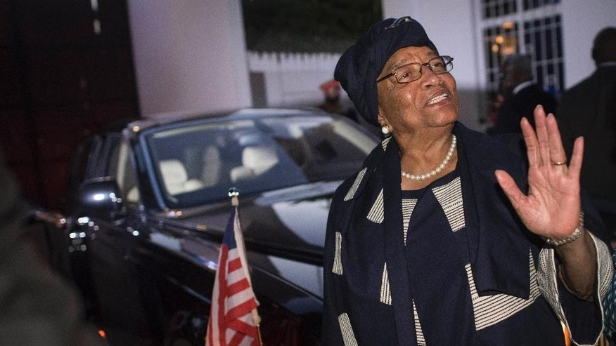 FILE - In this Tuesday, Dec.13, 2016 file photo, Liberia President and chair of the West African regional bloc, Ellen Johnson Sirleaf, waves following a meeting with Ecowas delegation in Banjul, Gambia. The chair of the West African regional bloc has said the body stands with the people of Gambia in their fight to ensure that democracy prevails, and will apply diplomatic solutions to solve the crisis. (AP Photo/ Sylvain Cherkaoui, File)