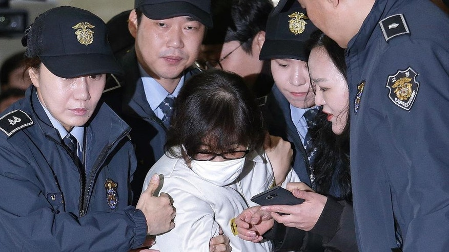 "FILE - In this Dec. 24, 2016, file photo, Choi Soon-sil, center, the jailed confidante of disgraced South Korean President Park Geun-hye, arrives for questioning into her suspected role in political scandal at the office of the independent counsel in Seoul, South Korea. A lawyer for South Korea's disgraced president has compared her impeachment to the ""unjust"" deaths of Jesus Christ and the ancient Greek thinker Socrates. That might be over the top, but the country's second impeachment trial will have major implications on the world's 11th largest economy and its tense standoff with nuclear-armed North Korea. (AP Photo/Ahn Young-joon, Pool, File)"