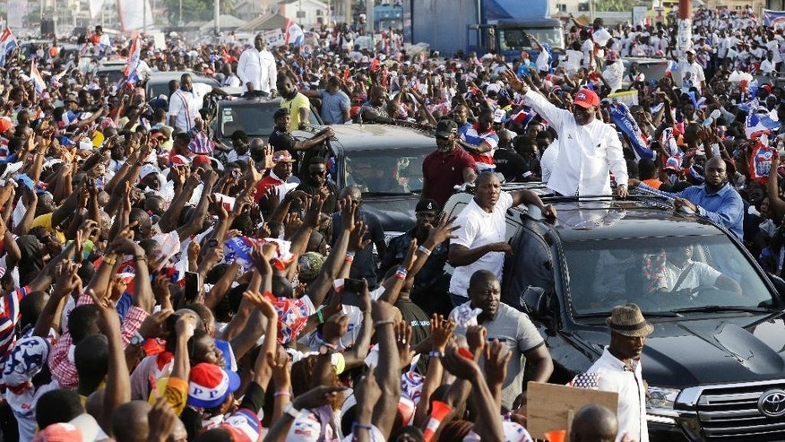 FILE- In this Sunday Dec. 4, 2016 file photo, Nana Akufo-Addo, presidential candidate of the opposition New Patriotic Party waves to his supporters during a presidential election rally in Accra, Ghana. Ghana's chief justice swore in the nation's newly elected President Nana Akufo-Addo amid a sea of people dressed in the red, blue and white colors of his party. Akufo-Addo, 72, won the Dec. 7 election on his third run for the office, defeating incumbent John Dramani Mahama. (AP Photo/Sunday Alamba File)