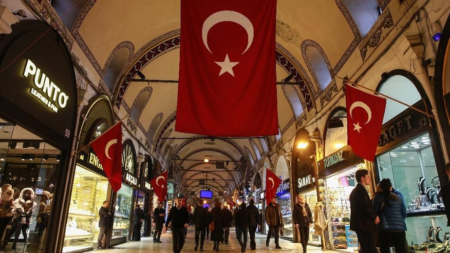 In this Thursday, Jan. 5, 2017 photo, Turkish flags decorate Istanbul's Grand Bazaar, one of Istanbul's main tourist attractions. Turkey's economy is suffering in the face of a string of extremist attacks _ including this week's nightclub massacre of New Year's revelers, most of them foreigners _ and uncertainty following the failed coup in July against President Recep Tayyip Erdogan that saw more than 270 people killed. (AP Photo/ Emrah Gurel)