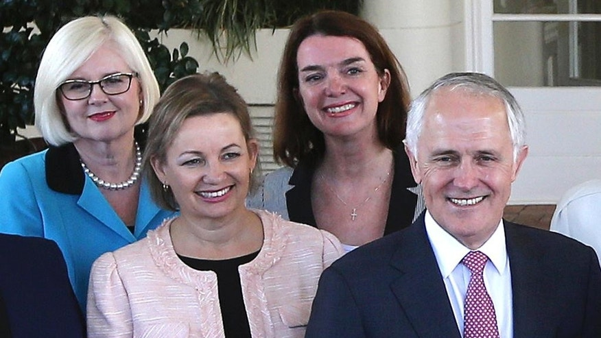 FILE - In this Sept. 21, 2015, file photo, Australia's Health Minister Sussan Ley, left in foreground, poses with Prime Minister Malcolm Turnbull, right, for a group photo after they were sworn in at Government House in Canberra, Australia. Ley stood aside while her travel expense claims are investigated. The scandal surrounding Ley's expense claims could trigger the first reshuffle of Turnbull's Cabinet since his government was re-elected in July 2106. Turnbull said Ley had agreed to stand aside on Monday, Jan. 9, 2017 without ministerial pay while the prime minister's department investigated whether her expense claims met guidelines. (AP Photo/Rob Griffith, File)