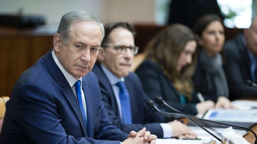 Israeli Prime Minister Benjamin Netanyahu, left, attends the weekly cabinet meeting at his office in Jerusalem, Sunday, Jan. 8, 2017. (Abir Sultan, Pool via AP)