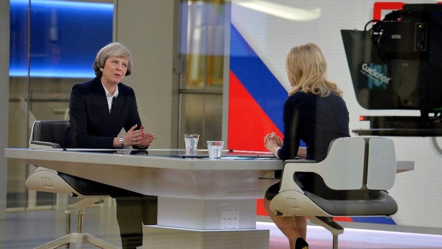 "Britain's Prime Minister Theresa May, left, is interviewed by Sophy Ridge for a television channel, in London, Sunday Jan.  8, 2017. May said Sunday she will announce details of Britain's European Union exit plans in the next few weeks, and denied a former diplomat's claim that the government is ""muddled"" about Brexit. (John Stillwell/PA via AP)"