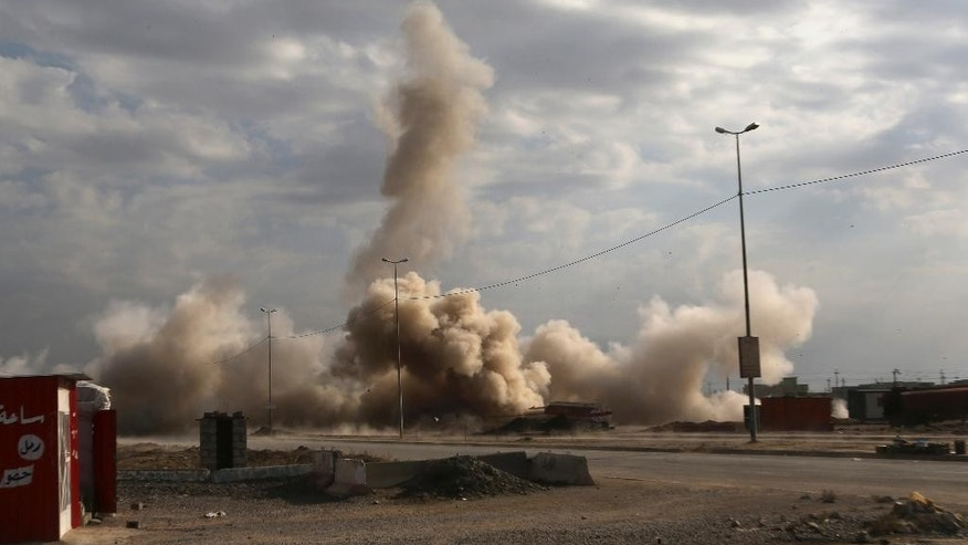 Smoke rises as Iraqi federal police detonate unexploded bombs set by Islamic State militants in the eastern side of Mosul, Iraq, Sunday, Jan. 8, 2017. (AP Photo/ Khalid Mohammed)