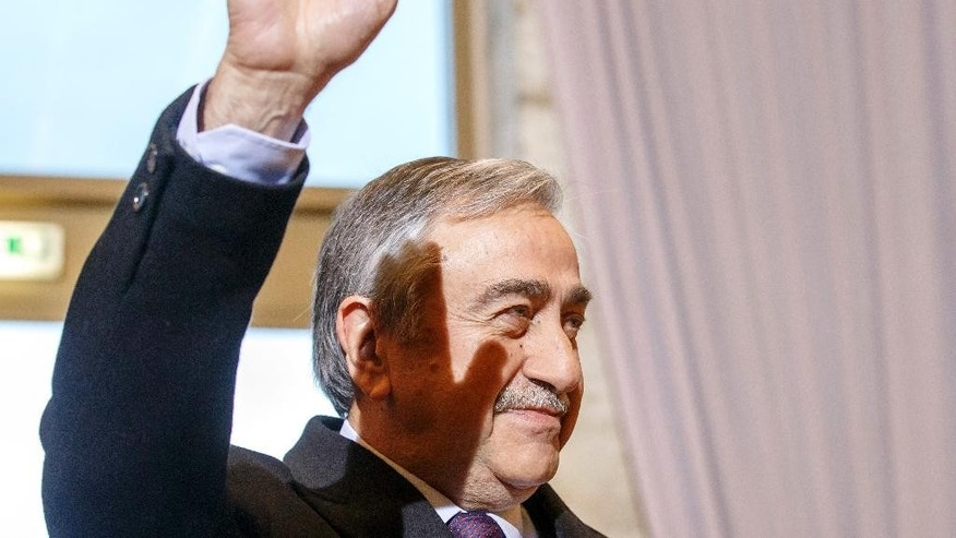 Turkish Cypriot leader Mustafa Akinci waves as he arrives for a new round of Cyprus peace talks at the European headquarters of the United Nations in Geneva, Switzerland, Monday, Jan. 9, 2017. (Salvatore Di Nolfi/Pool Photo via AP)