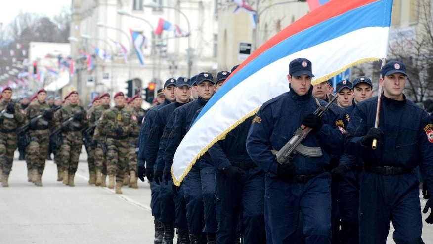 Members of police forces of Republic of Srpska march during a parade marking 25th anniversary of Republic of Srpska in the Bosnian town of Banja Luka, Bosnia, on Monday, Jan. 9, 2017.  The Jan. 9 holiday commemorates the date in 1992 when Bosnian Serbs declared the creation of their own state in Bosnia, igniting the country's devastating 4-year war. (AP Photo/Radivoje Pavicic)