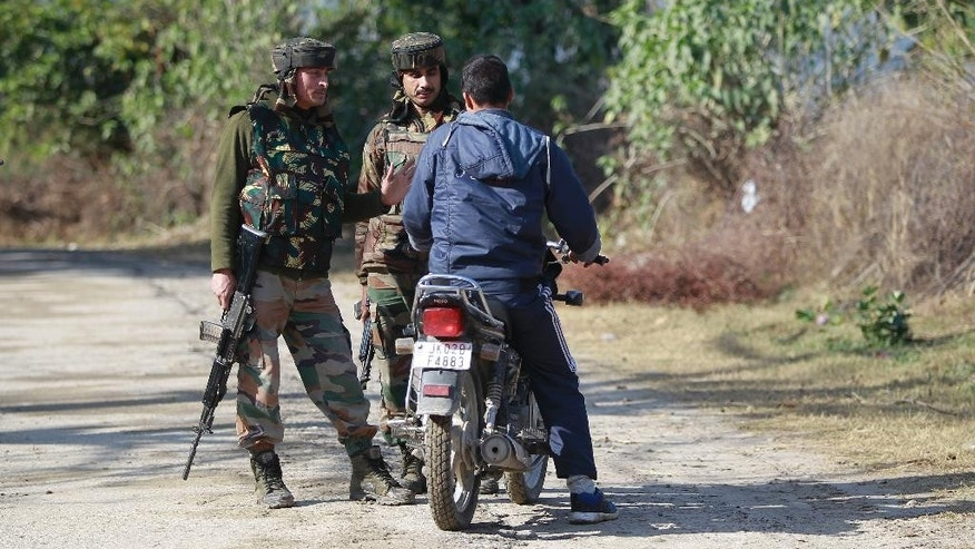 Indian army soldiers stop a civilian during a search operation outside the camp of the General Engineering Reserve Force (GREF), the site of a militant attack, in the frontier Battal area, about 90 kilometers from Jammu, India, Monday, Jan. 9, 2017. The Indian army says three civilian laborers working with an army road construction crew were killed in a pre-dawn militant attack near the border with Pakistan in Indian-controlled Kashmir. (AP photo/Channi Anand)