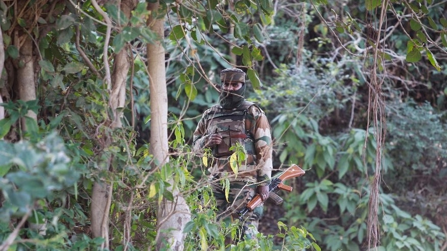 An Indian soldier patrols during a search operation outside the camp of the General Engineering Reserve Force (GREF), the site of a militant attack, in the frontier Battal area, about 90 kilometers from Jammu, India, Monday, Jan. 9, 2017. The Indian army says three civilian laborers working with an army road construction crew were killed in a pre-dawn militant attack near the border with Pakistan in Indian-controlled Kashmir. (AP photo/Channi Anand)