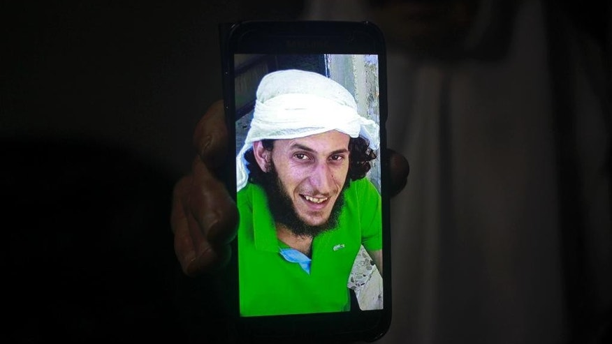 A relative shows a mobile phone photo of Fadi Qunbar, 28, outside his home in Jerusalem, Sunday, Jan. 8, 2017. Qunbar was identified as the man who drove a truck into a group of Israeli soldiers in Jerusalem Sunday, killing four people and wounding 15 others in one of the deadliest attacks of a more than yearlong campaign of violence. Prime Minister Benjamin Netanyahu said the driver was a supporter of the Islamic State group, and suggested the attack was inspired by similar assaults in Europe, without providing any evidence. (AP Photo/Mahmoud Illean)