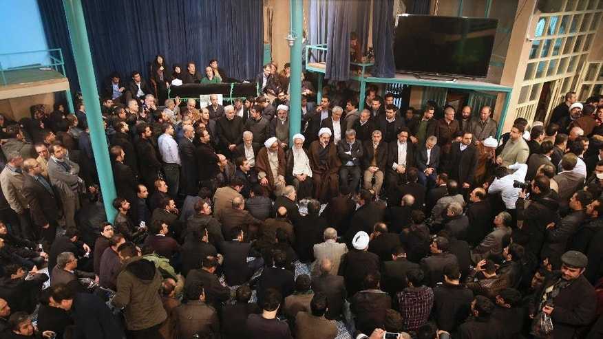 Family members, relatives, and officials mourn while surrounding the coffin of Iran's former President Akbar Hashemi Rafsanjani, top left, at the Jamaran mosque in northern Tehran, Iran, Sunday, Jan. 8, 2017. Rafsanjani died Sunday after a decades-long career in the ruling elite, where his moderate views were not always welcome but his cunning guided him through revolution, war and the country's turbulent politics. (AP Photo/Vahid Salemi)