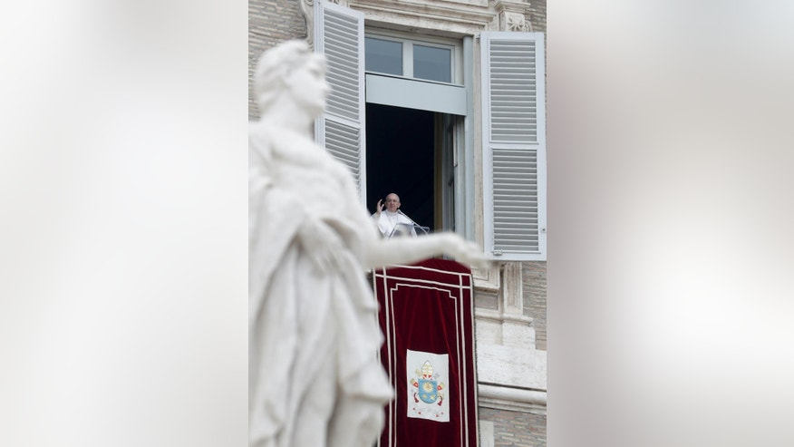 Pope Francis delivers his blessing during the Angelus noon prayer he celebrated from the window of his studio overlooking St. Peter's Square, at the Vatican, Sunday, Jan. 8, 2017. (AP Photo/Andrew Medichini)