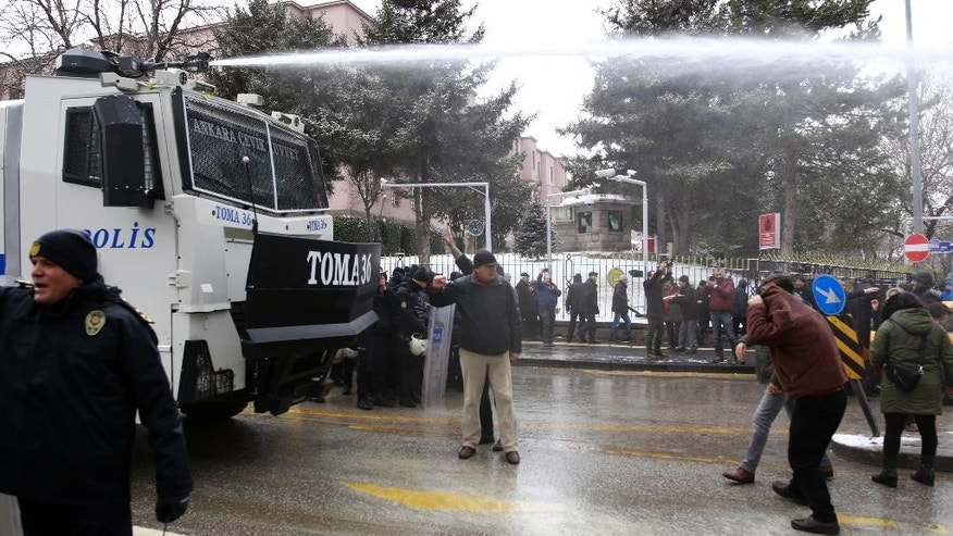 Riot police use a water cannon to disperse protesters as dozens of demonstrators gather in front of Turkey's parliament to protest proposed amendments to the country's constitution that would hand sweeping executive powers to President Recep Tayyip Erdogan's largely ceremonial presidency, in Ankara, Turkey, Monday. Jan. 9, 2017. Parliament is kicking off a debate Monday on a set of draft amendments.(AP Photo)