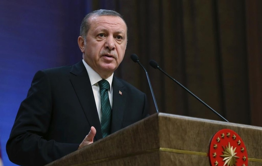 Turkey's President Recep Tayyip Erdogan speaks during an award ceremony in Ankara, Turkey, Thursday, Dec. 29, 2016. Turkey on Thursday rejected Washington's denials that it has provided weapons to a Syrian Kurdish militia force which Ankara considers to be a terrorist group and again complained about a lack of support from the U.S.-led coalition to its offensive against the Islamic State group in northern Syria. (Yasin Bulbul, Presidential Press Service, Pool photo via AP)
