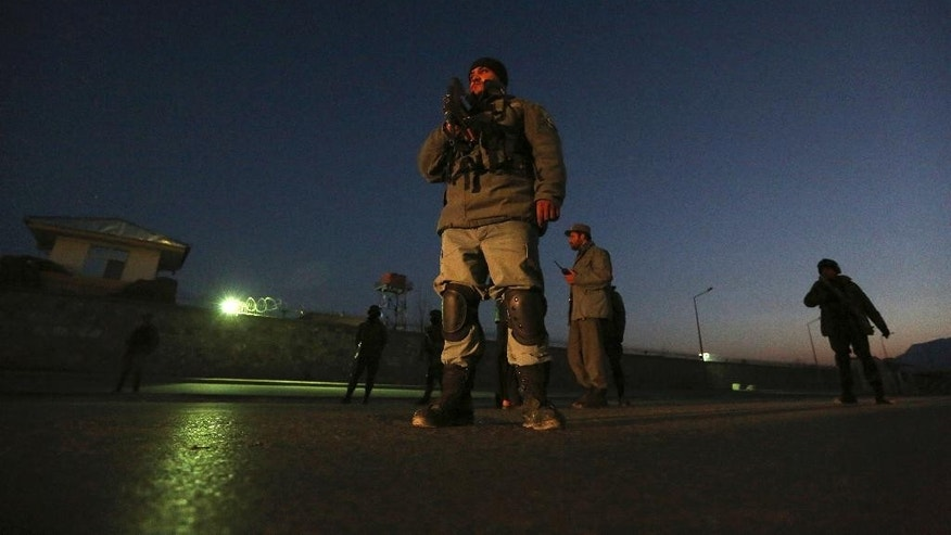 Afghan security forces inspect the site of two large bombings in Kabul, Afghanistan, Tuesday, Jan. 10, 2017. Two loud explosions rocked the Afghan capital of Kabul, causing casualties. The target of the blasts was probably an area that includes government and lawmakers' offices. Sediq Sediqqi, spokesman for the Interior Ministry, said that first, a suicide bomber carried out an attack, followed by a second explosion, caused by car bomb parked near the site. (AP Photo/Rahmat Gul)