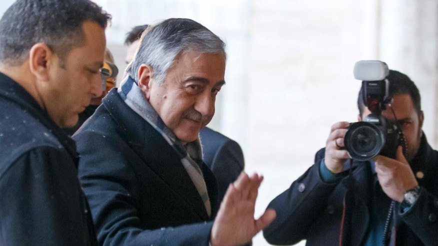 Turkish Cypriot leader Mustafa Akinci arrives for the second day for Cyprus peace talks at the European headquarters of the United Nations in Geneva, Switzerland, Tuesday, Jan. 10, 2017. (Salvatore Di Nolfi/Keystone via AP)