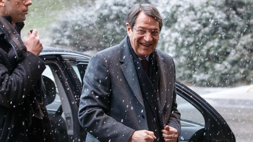 Greek Cypriot President Nicos Anastasiades arrives for the second day of Cyprus peace talks at the European headquarters of the United Nations in Geneva, Switzerland, Tuesday, Jan. 10, 2017. (Salvatore Di Nolfi/Keystone via AP)