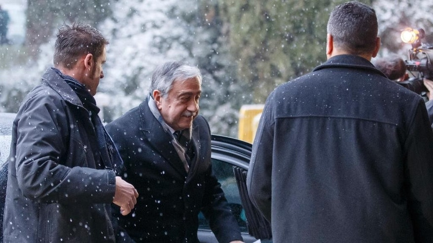 Turkish Cypriot leader Mustafa Akinci arrives for the second day of Cyprus peace talks at the European headquarters of the United Nations in Geneva, Switzerland, Tuesday, Jan. 10, 2017. (Salvatore Di Nolfi/Keystone via AP)