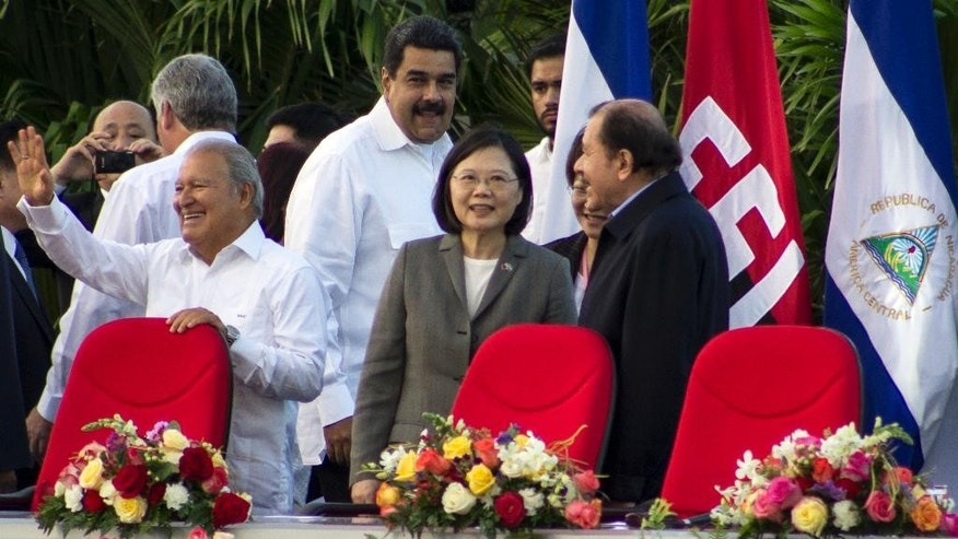 Nicaragua's President Daniel Ortega, right, welcomes Taiwan's President Tsai Ing-wen, center, at the start of his swearing-in ceremony in Managua, Nicaragua, Tuesday, Jan. 10, 2017. Also attending are El Salvador President Salvador Sanchez Ceren, left, and Venezuela's President Nicolas Maduro, behind center. The Taiwanese leader is in Nicaragua as part of a weeklong state tour to reinforce Taiwanese relations in Central America. (AP Photo/Miguel Alvarez)