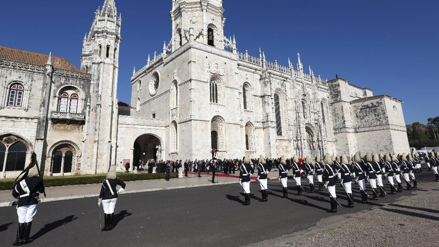The honor guard stands outside Lisbon's Jeronimos monastery on Monday, Jan. 9 2017, as the casket of former prime minister and president of Portugal Mario Soares arrives to lie in state. Soares, who helped steer his country toward democracy after a 1974 military coup, died Saturday aged 92. A state funeral will be held Tuesday. (AP Photo/Armando Franca)
