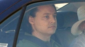 Dec. 29, 2007: Former Guantanamo terror prisoner David Hicks is driven away from Yatala high security prison with an unidentified woman in Adelaide, Australia.