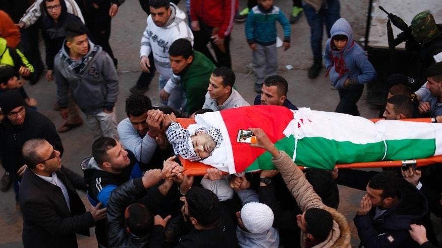 Palestinians carry 32-year-old Mohammed al-Salhi during his funeral  in Fara Refugee Camp near the West Bank city of Nablus, Tuesday, Jan. 10 2017. Israeli military said troops have shot dead al-Salhi when he tried to stab soldiers in the West Bank. Palestinians said al-Salhi was shot dead in his home. (AP Photo/Majdi Mohammed)