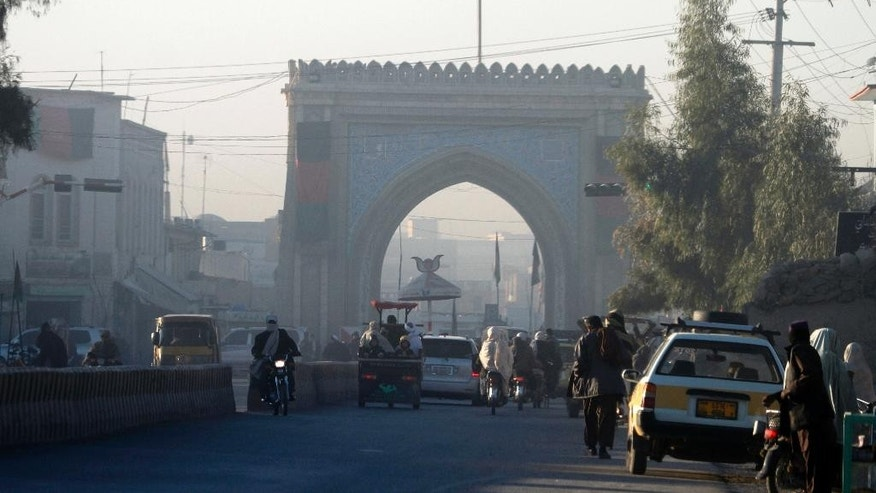 Afghans pass the main gate of the governor's office in Kandahar, Afghanistan, Wednesday, Jan. 11, 2017. The United Arab Emirates says five of its diplomats were killed in a bombing in Kandahar, Afghanistan, the previous day. (AP Photos/Allauddin Khan)