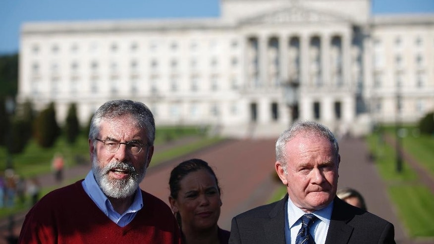 FILE- In this Tuesday, Sept. 8, 2015 file photo, Sinn Fein's Gerry Adams, left, and Martin McGuinness speak to the media at Stormont, Belfast, Northern Ireland. Northern Ireland's power-sharing government was plunged into crisis Monday, Jan. 9, 2017, as the senior Catholic leader announced he was quitting in a showdown with his Protestant colleague that could unravel a central achievement of peacemaking. (AP Photo/Peter Morrison, File)