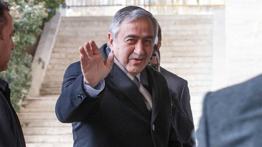 Turkish Cypriot leader Mustafa Akinci arrives for the third day of Cyprus peace talks at the European headquarters of the United Nations in Geneva, Switzerland, Wednesday, Jan. 11, 2017. (Salvatore Di Nolfi/Keystone via AP)