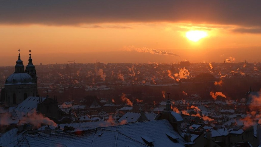 Smoke rises from chimneys during a freezing winter morning in Prague, Czech Republic, Wednesday, Jan. 11, 2017. Central Europe has been hit by unusually freezing weather in recent days. (AP Photo/Petr David Josek)