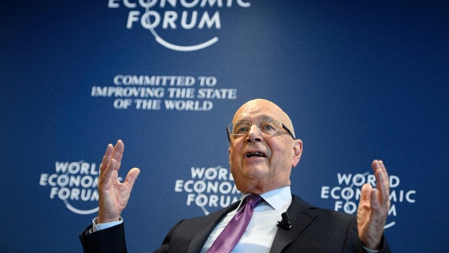 "German Klaus Schwab, founder and president of the World Economic Forum, WEF, gestures during a press conference, in Cologny near Geneva, Switzerland, Tuesday, Jan. 10, 2017. The World Economic Forum unveiled the program for its annual meeting in Davos, Switzerland, including the key participants, themes and goals. The overarching theme of the meeting, which will take place from Jan. 17 to 20, is ""Responsive and Responsible Leadership"". (Laurent Gillieron/Keystone via AP)"