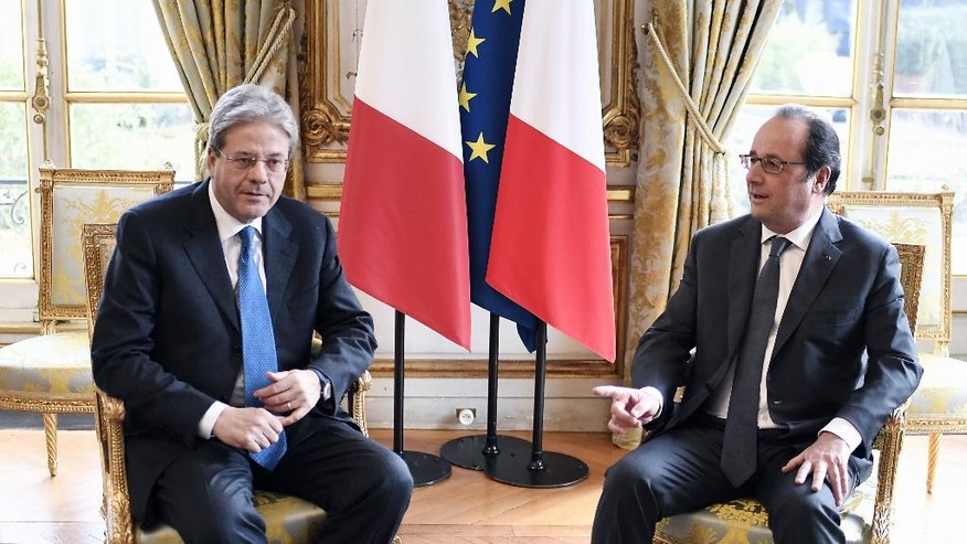 French President Francois Hollande, right, gestures towards Italian Premier Paolo Gentiloni during their talks at the Elysee Palace in Paris, Tuesday, Jan.10, 2017. (Stephane de Sakutin, Pool via AP)