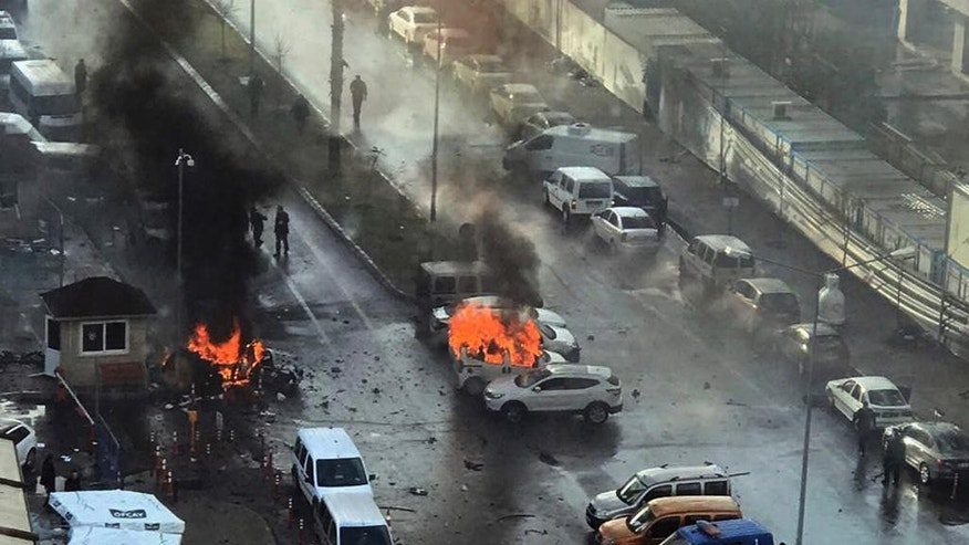 FILE - In this Jan. 5, 2017 file photo, cars burn after a car bomb explosion in Izmir, Turkey. Kurdish militant group TAK claimed responsibility for the Izmir attack, which killed a policeman and a courthouse employee, according to a Firat News Agency report on Wednesday, Jan. 11, 2017. (DHA-Depo Photos, File via AP)
