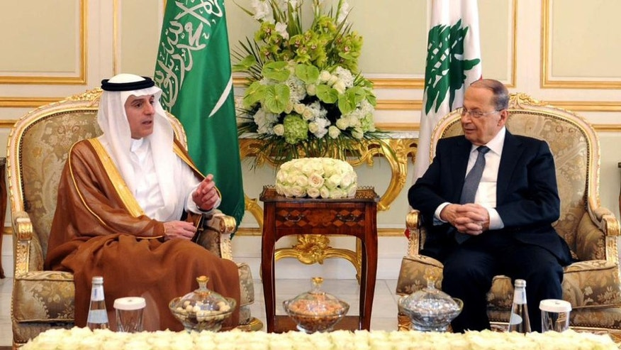 In this Tuesday Jan. 10, 2017 photo released by Saudi Press Agency, SPA, and made available today, President Michel Aoun of Lebanon, right, is received by Saudi Foreign Minister Adel Al-Jubeir in Riyadh, Saudi Arabia. (Saudi Press Agency via AP)
