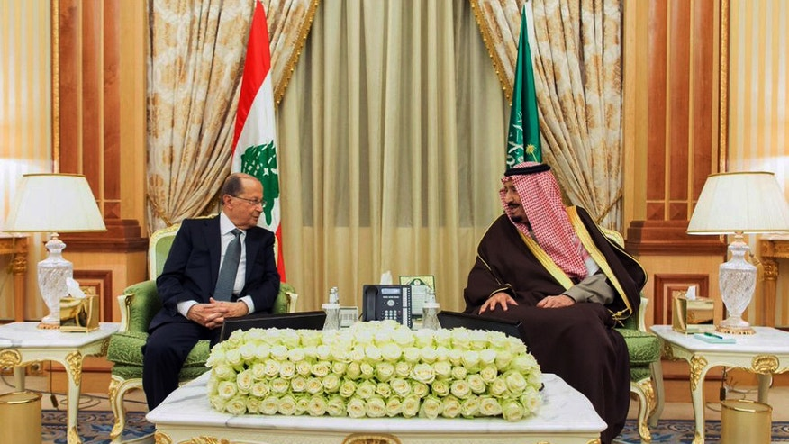 In this Tuesday Jan. 10, 2017 photo released by Saudi Press Agency, SPA, and made available today, President Michel Aoun of Lebanon, left, is received by Saudi King Salman in Riyadh, Saudi Arabia. (Saudi Press Agency via AP)