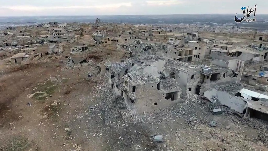 This still image taken from drone footage posted online Monday, Jan. 2, 2017 by the Aamaq News Agency, a media arm of the Islamic State group, purports to shows an aerial image of a neighborhood damaged by Turkish airstrikes in the northern Syrian town of al-Bab, in Aleppo province, Syria. Nearly two months into the assault, Turkey has become bogged down in an unexpectedly bloody fight to retake the Islamic State group's last stronghold in northern Syria. It has been forced to pour in troops, take the lead in the battle from its Syrian allies and reach out to Russia for aerial support -- a move that tests its alliance with the United States and the Syrian opposition. (Aamaq News Agency via AP)