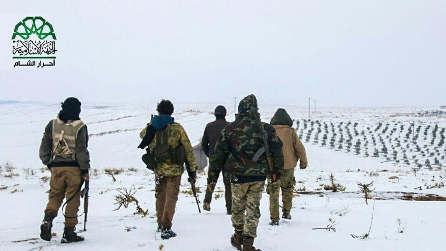 This photo posted Dec. 23, 2016, by the Syrian militant group Ahrar al-Sham, purports to show Ahrar al-Sham fighters on patrol in the countryside around the northern Syrian town of al-Bab, Aleppo province, Syria. Nearly two months into the assault, Turkey has become bogged down in an unexpectedly bloody fight to retake the Islamic State group's last stronghold in northern Syria. It has been forced to pour in troops, take the lead in the battle from its Syrian allies and reach out to Russia for aerial support -- a move that tests its alliance with the United States and the Syrian opposition. (Ahrar al-Sham, via AP)
