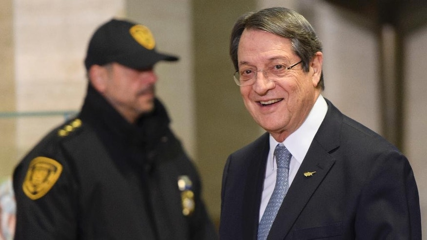 Greek Cypriot President Nicos Anastasiades arrives for the conference on Cyprus on the sideline of the Cyprus peace talks at the European headquarters of the United Nations in Geneva, Switzerland, on Thursday, Jan. 12, 2017. (Martial Trezzini/Keystone via AP)
