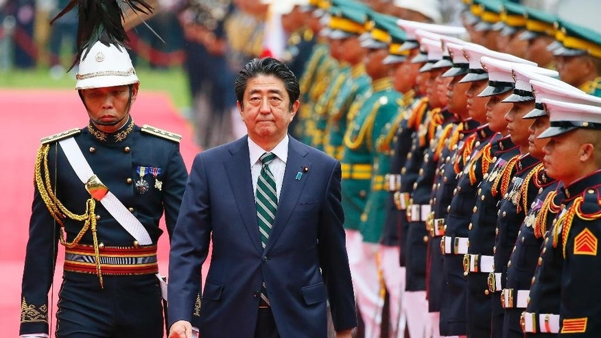 Japanese Prime Minister Shinzo Abe reviews the troops during a welcoming ceremony at the Malacanang Palace grounds, Thursday, Jan. 12, 2017, in Manila, Philippines. Abe arrived Thursday for a two-day official visit that includes a visit to President Rodrigo Duterte's hometown of Davao city in southern Philippines. (AP Photo/Bullit Marquez)