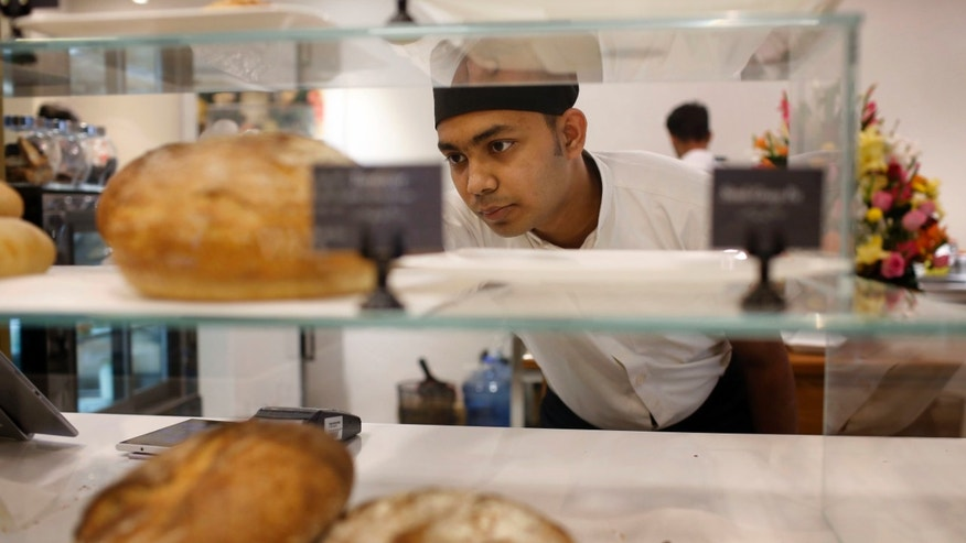 Dwin Islam Rakib, a survivor of the July 1 attack at Holey Artisan Bakery, works at the reopened restaurant in Dhaka, Bangladesh, Thursday, Jan. 12, 2017. The Bangladesh cafe besieged by militants who killed 20 hostages last year has quietly reopened in a shopping mall a few blocks from its old, bloodied site. Staff members said this week's reopening of the Holey Artisan Bakery represents a new beginning. (AP Photo)
