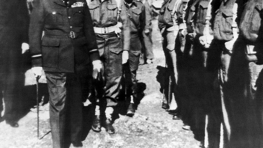 FILE - In this Feb. 1, 1943 file photo, Britain's Prime Minister Winston Churchill inspects the 4th Hussars, a regiment in which he once served, during his visit to Cyprus, which was then a British colony. Talks on reunifying the small Mediterranean island nation of Cyprus are now at a critical juncture with top officials from Britain, Greece, and Turkey joining the talks in Geneva Thursday, Jan. 12 , to tackle the thorny issue of security. (AP Photo, File)
