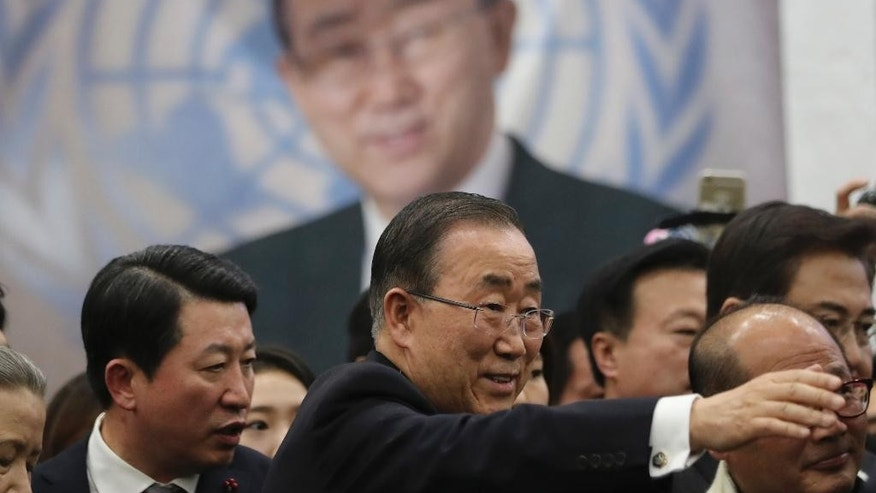 Former U.N. Secretary-General Ban Ki-moon tries to shake hands with supporters as he leaves at Incheon International Airport in Incheon, South Korea, Thursday, Jan. 12, 2017. The former U.N. Secretary-General has returned to native South Korea amid widespread expectations he'll run for president. (AP Photo/Lee Jin-man)