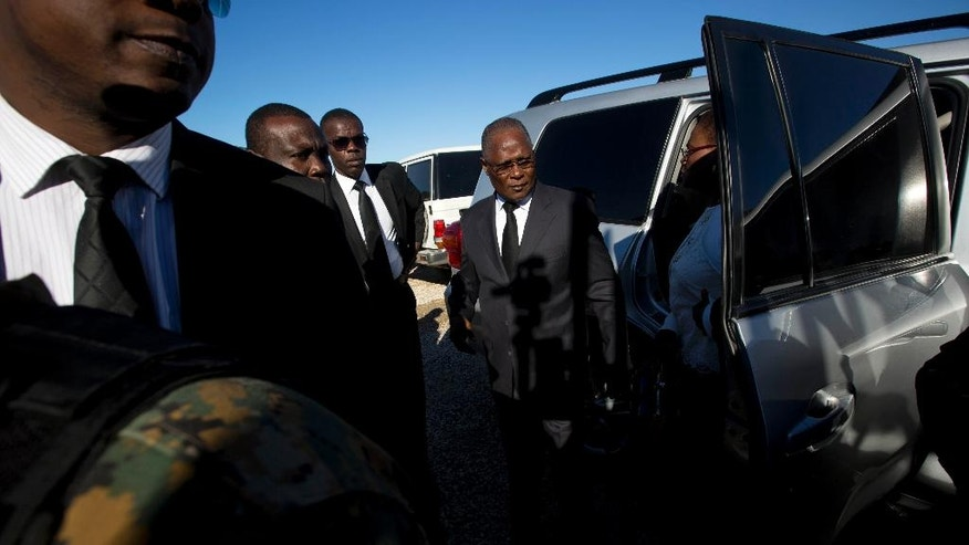 Haiti's Interim President Jocelerme Privert, center, arrives to a memorial service marking the seventh anniversary of the 2010 earthquake, north of Port-au-Prince, Haiti. Thursday, Jan. 12, 2017. The 2010 earthquake caused major damage in Port-au-Prince, Jacmel and other settlements in the region killing tens of thousands. ( AP Photo/Dieu Nalio Chery)