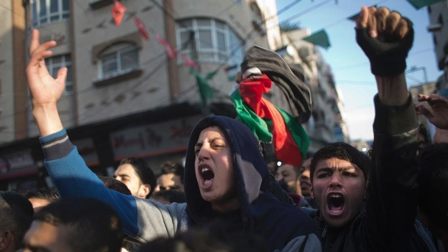 Palestinians chant slogans during a demonstration against the chronic power cuts in Jabaliya refugee camp, northern Gaza Strip, Thursday, Jan. 12, 2017. Thousands of people took to the streets on Thursday to protest chronic power cuts in the Hamas-ruled Gaza Strip, in one of the largest unauthorized protests in the territory since the Islamic militant group took power a decade ago. (AP Photo/ Khalil Hamra)
