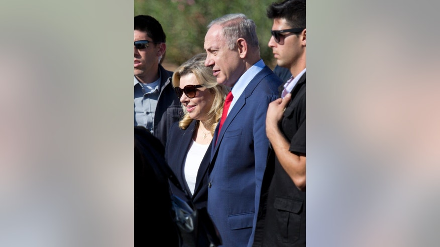 FILE -- In this Nov. 8, 2016 file photo, Israeli Prime Minister Benjamin Netanyahu, center, and his wife Sara attend an inauguration ceremony of the Hahemek rail line in the train station in Afula, Israel. Israeli media are reporting that police questioned the wife of Prime Minister Benjamin Netanyahu as part of the investigation into allegations that he improperly accepted gifts from wealthy supporters. Israel Radio and other media outlets reported Thursday, Jan. 12, 2017, that Sara Netanyahu was interviewed by police the night before. Police had no immediate comment. (AP Photo/Ariel Schalit, File)