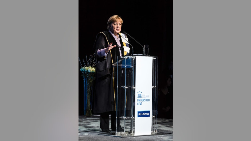 German Chancellor Angela Merkel talks after she was given an honorary doctorate by the University of Leuven and the University of Ghent during an academic ceremony in Brussels on Thursday Jan. 12, 2017. Merkel received the honorary doctorate for her diplomatic and political efforts to develop the political strength of Europe, and to defend the values that allow Europe to find unity in diversity. (AP Photo/Geert Vanden Wijngaert)