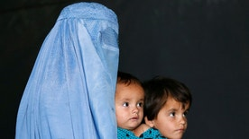 An Afghan family, returning from Pakistan, watch a short video clip about mines during a mines and explosives awareness program at a United Nations High Commissioner for Refugees (UNHCR) registration centre in Kabul, Afghanistan  September 27, 2016. Picture taken September 27, 2016. REUTERS/Mohammad Ismail  - RTSQGO4
