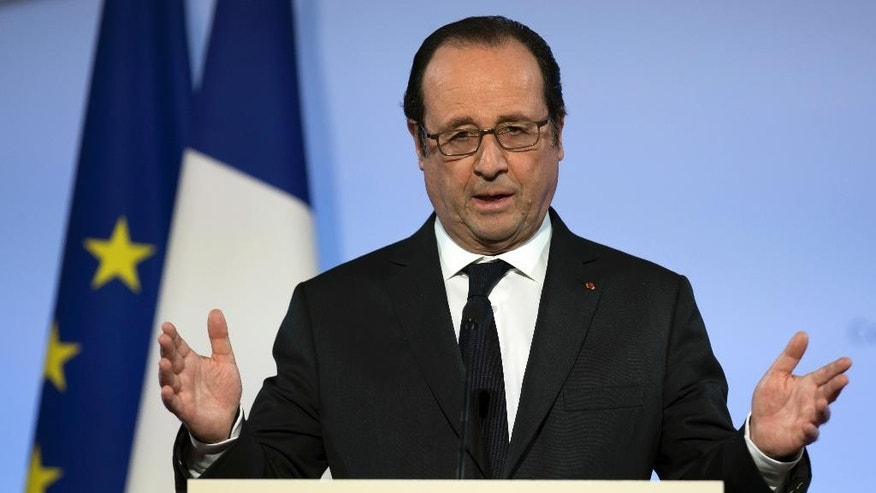 French president Francois Hollande delivers his new year address to diplomats, at the Elysee Palace in Paris,Thursday, Jan. 12 2017. Hollande says Sunday's Mideast peace conference in Paris aims at ensuring the support of the international community for the two-state solution as a reference for future direct negotiations. (Ian Langsdon, Pool via AP)